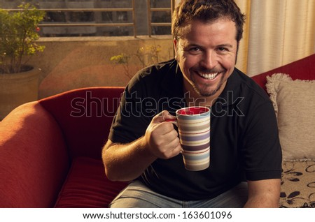 Man taking the afternoon tea at home - stock photo