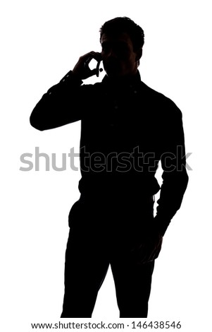 Man talking on cell phone in silhouette isolated over white background  - stock photo