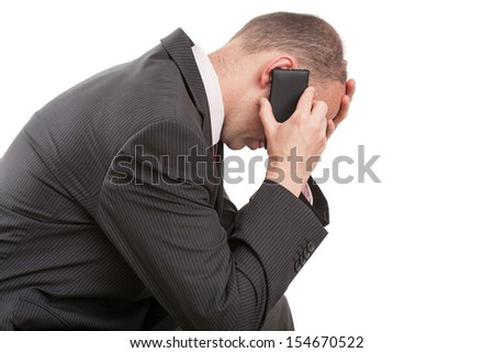 Man talking on the telephone and receiving bad news  - stock photo