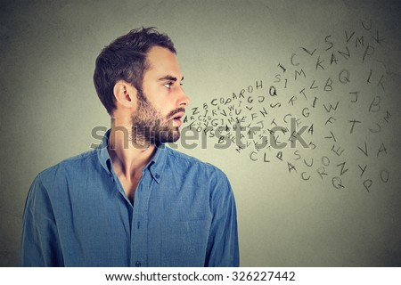 Man talking with alphabet letters coming out of his mouth. Communication, information, intelligence concept - stock photo