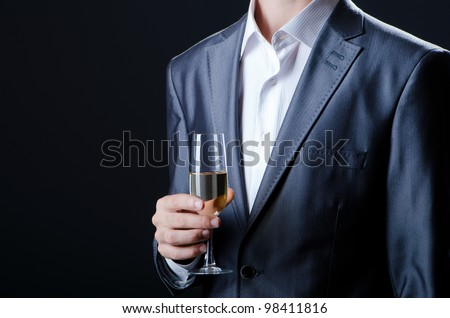 Man tasting wine in glass