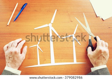 Man thinking about clean renewable energy. Abstract image with paper scrapbooking - stock photo