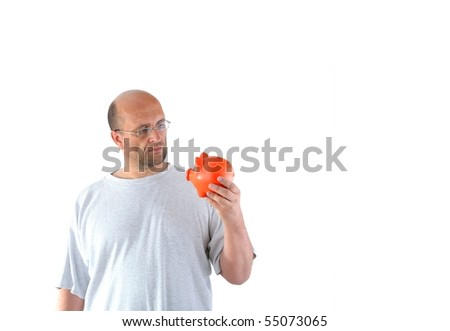 man thinking about his piggy bank - stock photo
