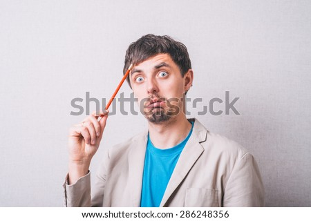 man thinking about something with pencil