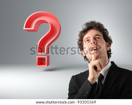 man thinking and 3d big red question mark - stock photo