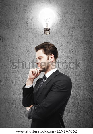 man thinking and lamp  on concrete  background