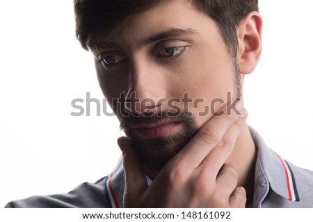 Man thinking and looking away. Close-up of a young man thinking and looking away - stock photo