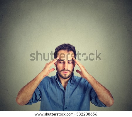 man thinking very intensely concentrating isolated on gray wall background  - stock photo