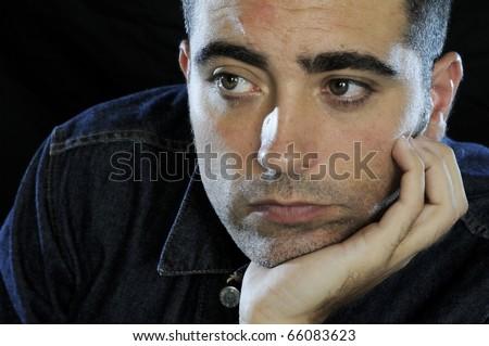 Man thinking with black background - stock photo