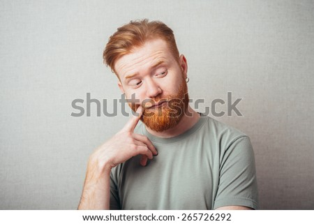 Man thinks finger mouth - stock photo