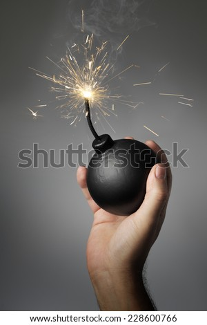Man throwing an old-style (fake) bomb. - stock photo