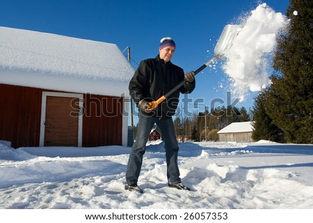 Man throwing snow in the air - stock photo