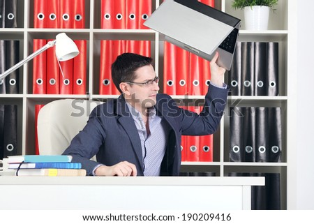 man throws laptop - stock photo