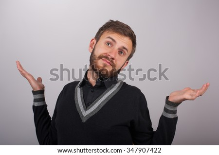 man throws up his hands showing he has nothing