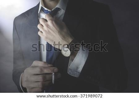 man tie hand cigarette - stock photo