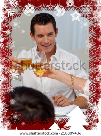 Man toasting with his mother in a Christmas dinner against christmas themed frame - stock photo