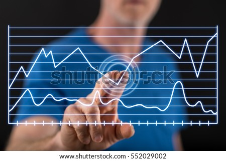 Man touching a business analysis on a touch screen with his finger