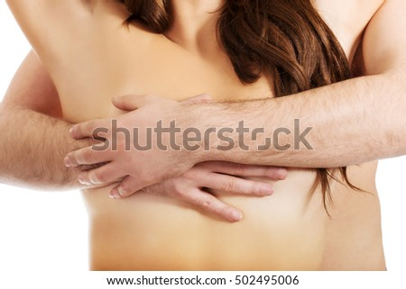 Man touching woman's breast.