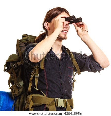 Man tourist backpacker looking through binoculars. Guy hiker backpacking. Summer vacation travel. Isolated on white background. - stock photo