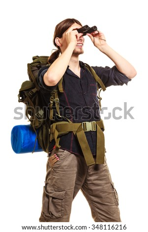 Man tourist backpacker looking through binoculars. Young guy hiker backpacking. Summer vacation travel. Isolated on white background. - stock photo