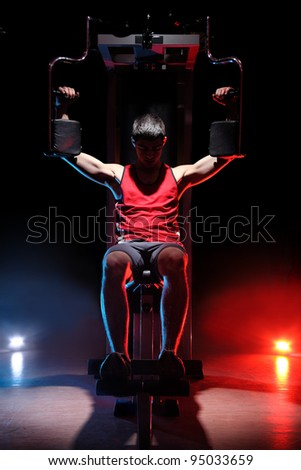 man training on gym isolated on black background - stock photo