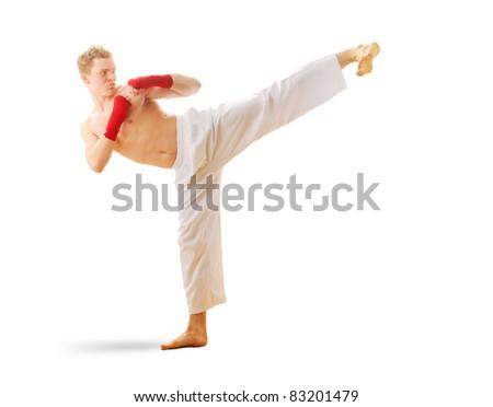 Man training taekwondo Isolated on white background - stock photo