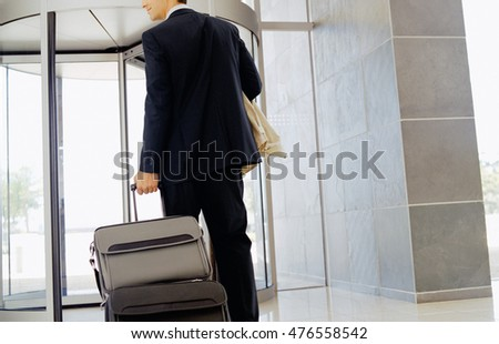 man traveling with leather bag