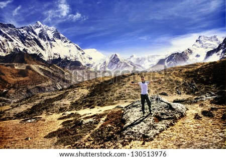 Man trekking in the Himalayas with view towards Mount Everest
