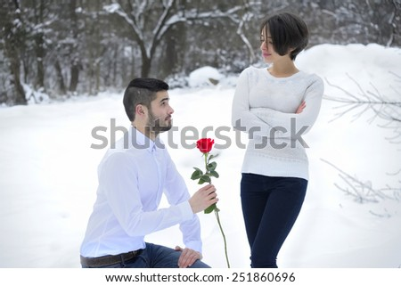 Man Tries To Apologize with Rose - stock photo