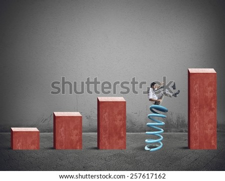 Man tries to climb the financial statistics - stock photo