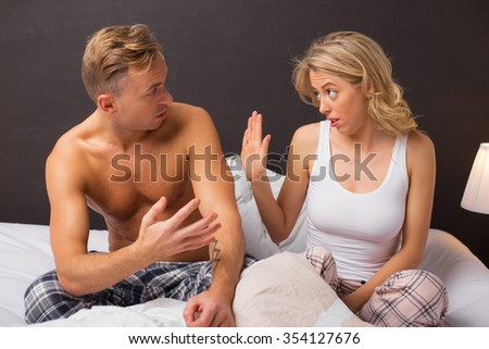 Man trying to explain something to his woman  - stock photo