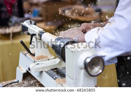 Man turning wood with lathe - stock photo