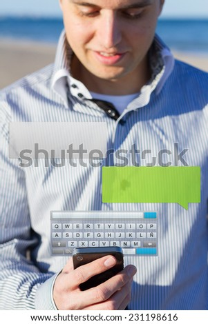 Man typing a message with smartphone, blurred background