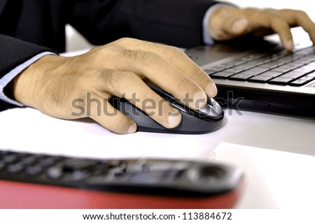 Man typing on laptop isolated over white background