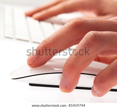man typing with keyboard on a white background - stock photo