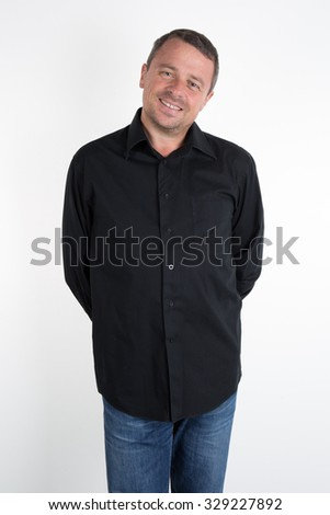Man, unshaven, with black shirt looking at the camera