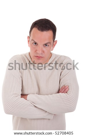 man upset with his arms crossed, isolated on white background. Studio shot. - stock photo