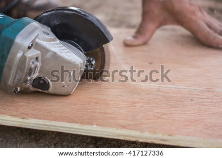 Man using a circular saw to cut plywood