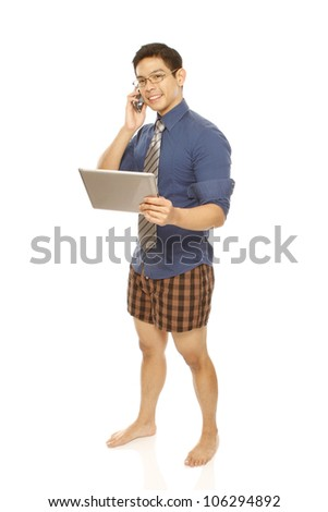 Man using a mobile phone and tablet computer while wearing boxer shorts with shirt/tie (isolated on white) - stock photo