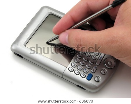 Man using a PDA with the stylus - stock photo