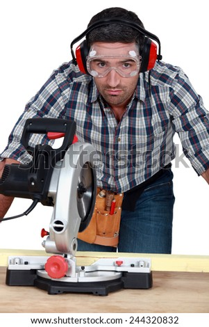 Man using band-saw - stock photo