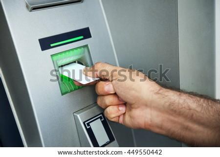 Man using cash machine - stock photo