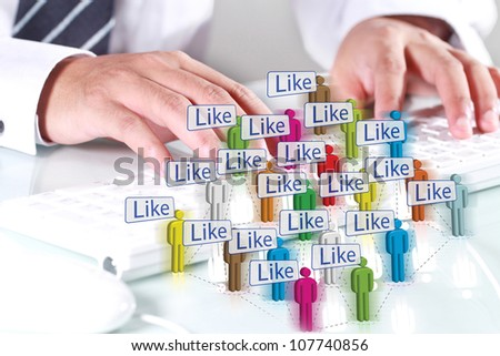 Man Using computer keyboard with illustrations. Social Network - stock photo