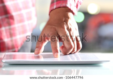 Man using digital tablet, Close-up - stock photo