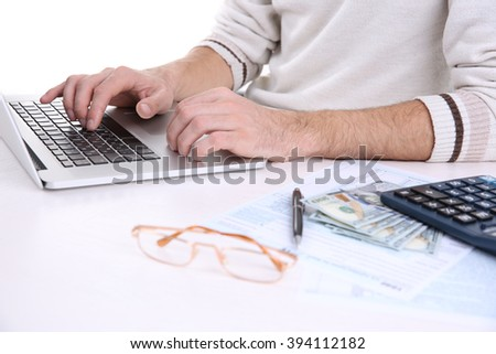 Man using laptop at the table - stock photo