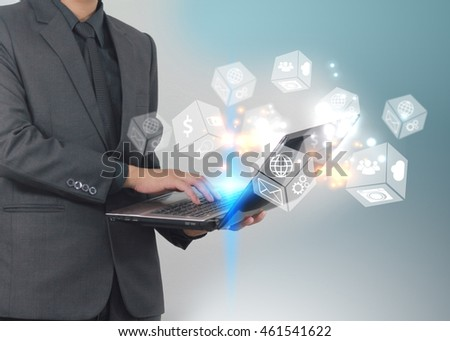 Man using laptop with social icons, Social media concept.