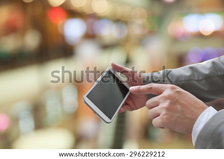 Man using mobile smart phone - stock photo