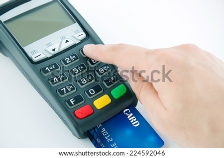 Man using payment terminal keypad, enter personal identyfication number - stock photo