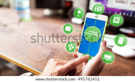 Man using smart home app on smartphone. Smart home, house automation remote control concept.