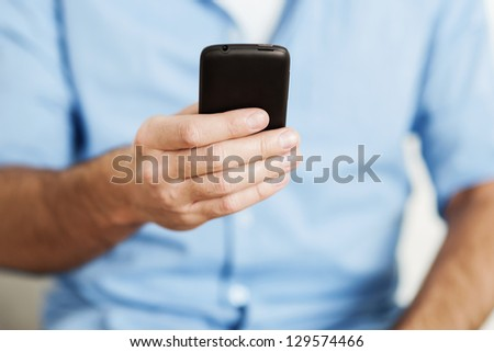 Man using smart phone - stock photo